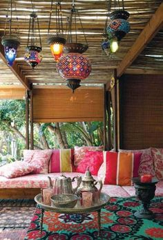 Love everything about this space. Lanterns. Tea pots. Tables. Shades. Everything.