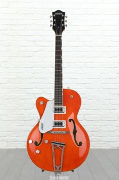 It hasn't always been easy to get a left-handed guitar. Southpaws rejoice — Sweetwater has your next guitar locked, loaded, and ready to go. Lefty Guitars, Acoustic Guitars, Left Handed Acoustic Guitar, Duane Eddy, Guitar Stand, Guitar For Beginners, Gretsch, Guitar Lessons, Playing Guitar