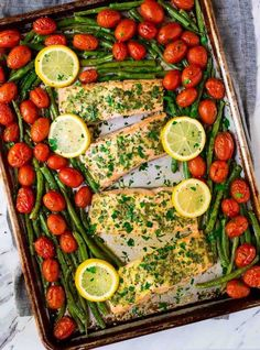 Easy Sheet Pan Baked Garlic Salmon with Lemon Butter and Veggies. Healthy, ready in 30 minutes, and everything cooks on ONE pan for easy clean up! Oven Baked Salmon, Healthy Salmon Recipes, Fish Recipes, Seafood Recipes, Keto Recipes, Dinner Recipes, Ketogenic Recipes, Healthy Dinners, Delicious Recipes