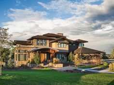 <div><ul><li>A distinctive domed entry porch adds lots of flair to this Craftsman house plan.</li><li>The intricate roof lines and stone accents give you a unique home.</li><li>Step up from the entry foyer to a wide hall with double doors that open to the music room.</li><li>Beams top the dining room adding a rustic feel.</li><li>More beams can be found in the vaulted great room that has a big fireplace at one end and is one step down from the other rooms.</li><li>The kitchen is enormous…