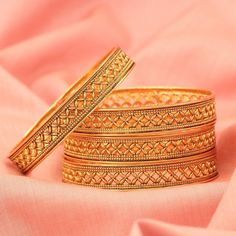 Charmingly designed set of four bangles, inspired by floral motif. The set is full gold plated, with texture work and design. Wear it with your ethnics for a casual party look to any occasion, and look graceful! Gold Bangles Design, Gold Jewellery Design, Gold Jewelry, Silver Bracelets, Jewellery Earrings, Bangle Bracelets, Amrapali Jewellery, Designer Bangles, Gold Plated Bangles