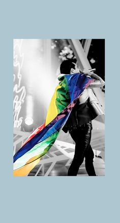 Brendon showing support for LGBTQ+ with a sassy walk and a rainbow flag. Love him ❤️