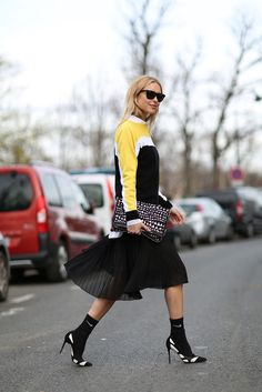 How To Dress Like A French Girl #refinery29 http://www.refinery29.com/63682#slide-29 Athletic socks and pumps add a funky twist to any outfit.