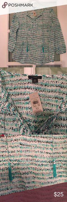 NWT Ann Taylor blouse with tastles This is the cutest top ever and it's NWT! Perfect to wear at work or over a bathing suit! Colors are black, green, and turquoise. 3/4 length sleeves. 72% cotton/28% silk. Ann Taylor Tops Blouses