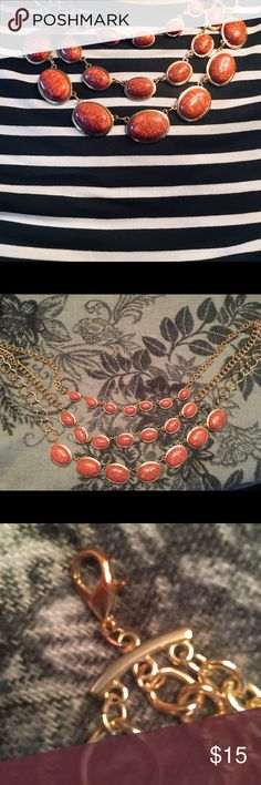 Statement Necklace Three strand chunky marbled coral stone and gold necklace that makes any outfit pop! Clasp is a little tarnished but doesn't affect the glam factor.  Like new from a smoke free home. Jewelry Necklaces