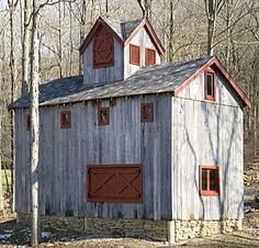 Old grey barn with reddish brown accents