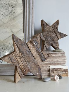 This fabulously solid & heavy, rustic, wooden star pieced together from reclaimed bits of wood, will add a natural woodland touch to any setting.