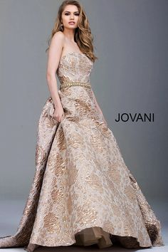 Floor length gold floral brocade evening ballgown with crystal embellished belt features strapless bodice with straight neckline and back zipper.