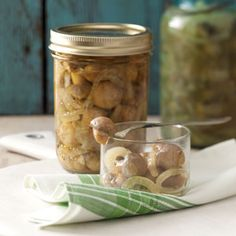 Tangy Pickled Mushrooms Recipe -Home-canned pickled mushrooms are a great addition to your pantry. They're ideal for… Pickled Mushrooms Recipe, Marinated Mushrooms, Stuffed Mushrooms, Canned Mushrooms, Vegetable Drinks, Vegetable Recipes, Canning Pickles, Oven Canning, Mushrooms