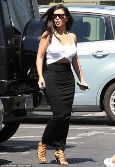 Raising temperatures: Kim Kardashian showed off her incredible curves in a high-waisted sk...