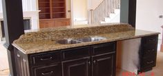 Granite is an attractive natural stone that will add colour and warmth to your kitchen. Granite is an extremely hard material that does not blister, scratch or crack. The hardness of granite is rivalled only be the hardness of diamonds. In fact diamonds are used to cut and polish granite.