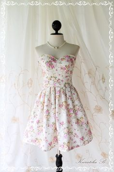 A Lovely Queen - Strapless Classic Cocktail Dress Light Cream Playful Glamorous Floral Print Giant Bow Party Night Prom Wedding Bridesmaid. $58.90, via Etsy.
