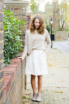 Four Fall Outfits | A Cup of Jo: taupe sweater layered over white dress + taupe booties