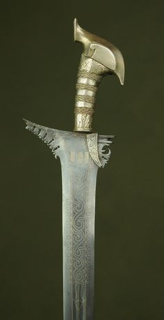 Moro Keris Sword  Dated: 18th century Culture: Javanese Medium: steel, silver, wood