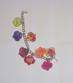 Be a sister to every girl scout shrinky dink charm bracelet - have each girl design one of the charms for everyone in the troop. OR Make it a girl scout law charm bracelet Girl Scout Swap, Girl Scout Leader, Girl Scout Troop, Girl Scout Activities, Group Activities, Daisy Petals, Girl Scout Camping, Girl Scout Juniors, Daisy Girl Scouts