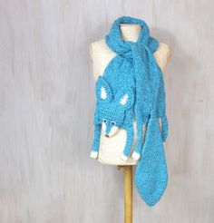 """Blue fox, handmade soft scarf Soft and nice blue turquoise fox — made by me, made of soft blue turquoise and white yarn, with plastic blue eyes on small pieces of polyfelt and plastic nose. Length with paws and tail: 83 (211 cm), without paws and tail (only """"body""""): 60 (154 cm) Width: 9 (22 cm) Made in a smoke free house. Ready to ship. Please check dimensions carefully. Due to lighting conditions and monitor settings, colors may appear slightly different, than they are. Items are desc..."""