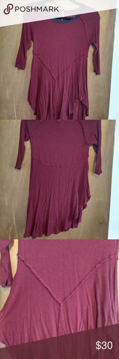 FREE PEOPLE ASYMMETRICAL LITE SWEATER SIZE SMALL FREE PEOPLE ASYMMETRICAL LITE SWEATER SIZE SMALL, DARK MAROON/RED WINE COLORED WITH NAVY BLUE TRIM. SWEATER is VERY VERY VERY THIN!!!! Suggest a camisole is worn underneath. Shirt is rayon and spandex. Free People Tops