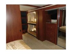 2011 Used Fleetwood Bounder 34B Class A in Oklahoma OK.Recreational Vehicle, rv, We are open to all reasonable offers on this amazing and upgraded RV. It has a Triple slide w/King bed/nightstand/overhead storage slide, 2 bunk bed/dresser/closet slide and loveseat/dinette/overhead storage slide. The additional slide in the bedroom provides a HUGE amount of room compared to those with a similar floorpan but only 2 slides. STANDARD FEATURES: include a Ford Triton V-10 Engine, Onan 5500 Gas…