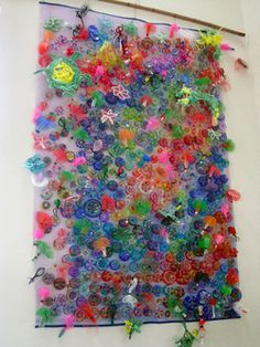 "Tapestry made from water bottle bottoms into ""diatoms,"" with pipe leaner starfish and produce netting jellyfish. Awesome!"