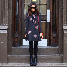 Cute in floral dress and black boots.