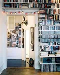Love those shelves and the stacked photographs.