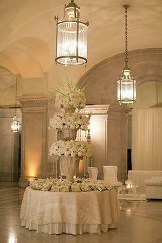 Escort Card Table | These urns stacked upon each other reach… | Flickr