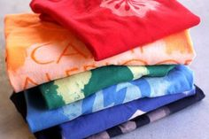 Bleach dyed shirts - so cool.  Tips to remember for next time - 100% cotton gives best results versus blend.  Check local thrift stores for cheap shirts.  Michael's also usually has a 5 for $10 sale around 4th of July.  Mist shirts from several feet above if using spray bottle.  Paint any design with brushes.
