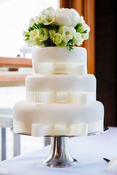 Simple white bow cake.