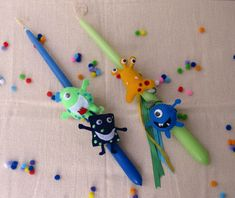 Scented Easter candles decorated with handmade felt little monsters. By La Boutique de Fleurs