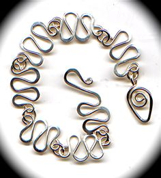 Images of various handmade chains for inspiration. From The WireWorkers Guild.
