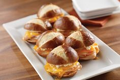 Serve these Turkey-Pretzel Sliders from My Food and Family on game day! Sandwiched on a pretzel roll and baked until the cheddar cheese melts, these turkey-pretzel sliders are simple to make and fun to share. Pretzel Rolls, Pretzel Bun, Sloppy Joe Burger, Turkey Melt, Hamburger Sliders, Slider Sandwiches, Kraft Recipes, Appetizer Dips, Melted Cheese