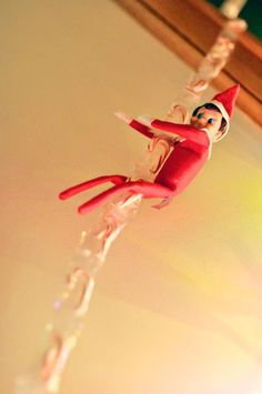 Elf on the Shelf idea - shimmying down a rope of candy canes