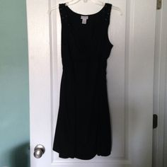 Classic and Comfortable Maternity Dress! Beautiful black maternity dress, sits right at the knees. Extremely comfortable.  Beading detail on each shoulder. In excellent condition, worn a handful of times. I always received many compliments when wearing!  Can be dressed up or kept casual! Motherhood Maternity Dresses