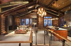 Beautiful open concept rustic kitchen/living room design by Studio Frank