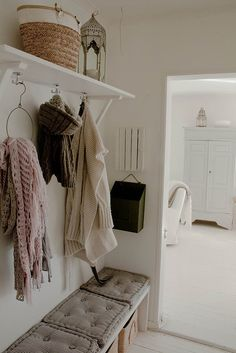 simple white shelving and bench - lovely styling for a boot room