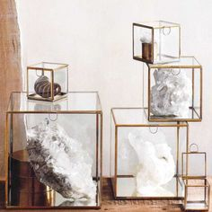 Elegant glass boxes with delicate brass edges and mirrored bases to display special objects and reflect light.        FINISH:Brass, Mirrored Glass    [share]