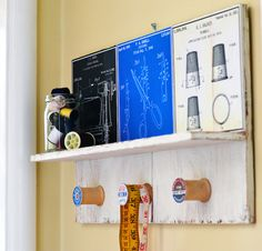 Use what you've got! This vintage inspired DIY wall shelf uses wood scraps I already had and sewing art to make a cool display. #Sewing #Organization #Spaces