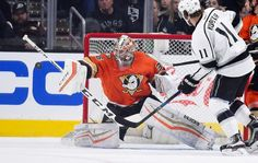 Anaheim Ducks goalie John Gibson, left, deflects a shot as Los Angeles Kings center Anze Kopitar, of Slovenia, watches during the first period of an NHL hockey game Thursday, Feb. 4, 2016, in Los Angeles. (AP Photo/Mark J. Terrill)