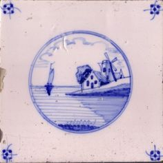English delftware tile with blue-and-white landscape design.