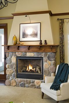 Interior Products | multiple, pre-finished, knotty alder mouldings make this fireplace a little more unique | Bayer Built Woodworks, Inc.