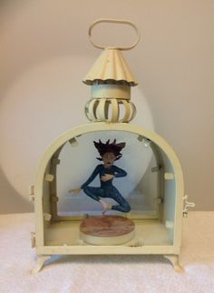She looks like she's floating in thin air. Polymer clay and found lantern.