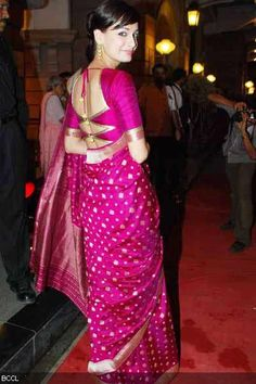 Pretty Saree! Love the blouse cut out!! Def going to get a blouse made like this!