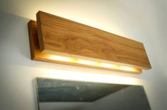 SC Sconce Wooden wall lamp with a simple functional design. Soft yellow LED lighting. This lamp has two options: switch is located aside, or with wire. Mad