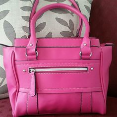 Pink Purse Adorable pink handbag. Medium sized. Very roomy. In great condition. Flaws shown in last pic.  * sorry no trades  * bundle and save  * feel free to make offers  * smoke free home Bags