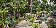 Stone pathways invite you to explore the expanse of this backyard oasis.