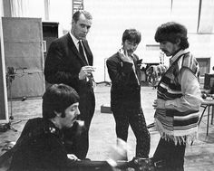 Paul, producer George Martin, John and George during the Sgt. Pepper sessions in 1967.