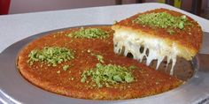 Shredded pastry with cheese and sugar syrup (künefe)