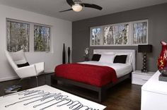modern, dark floor, white trim, gray wall with white and red accents.
