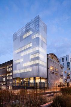 2b Architectes creates patchwork facade for concrete apartment block in Lausanne.