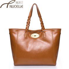 Aliexpress.com   Buy Cowhide female bags 2012 fashion formal crossbody shoulder  bag women fashion designer best selling item free drop shipping from ... 4a4fabd687